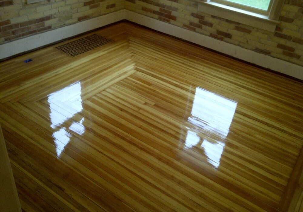 Bild Wood Floor - Refinished Antique Heart Pine with Herringbone Woven Corners - Grand Haven, MI